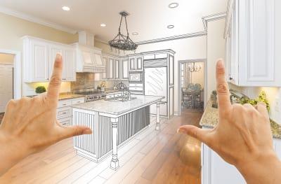 female hands framing gradated custom kitchen design drawing